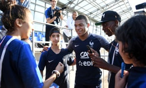 Kylian Mbappé poses with young fans from the Paris commune of Bondy at the end of a World Cup training session in Moscow.