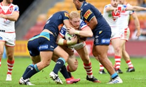 James Graham is tackled during the round six NRL match between the Gold Coast Titans and the St George Illawarra Dragons at Suncorp Stadium
