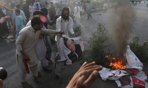 Protesters burn pictures of the Pakistan prime minister, Imran Khan, in Karachi last week