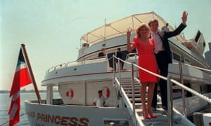 Donald and Ivana Trump wave to reporters as they board their luxury yacht The Trump Princess in New York City on 4 July 1988.