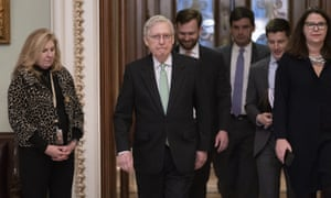 Mitch McConnell leaves the chamber after criticizing efforts to impeach Donald Trump.