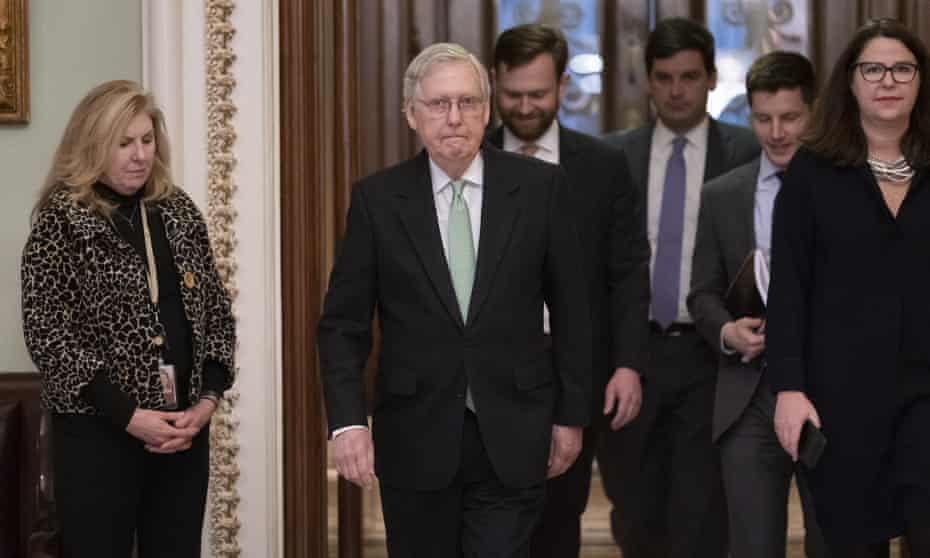 McConnell leaves the Senate chamber after criticizing the effort to impeach Trump.
