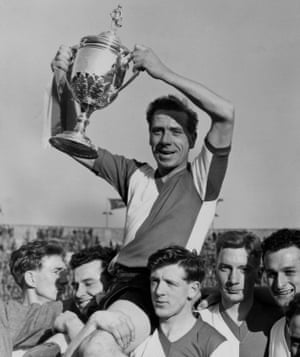 Charles Mortimore lifts the FA Amateur Cup at Wembley in 1958.