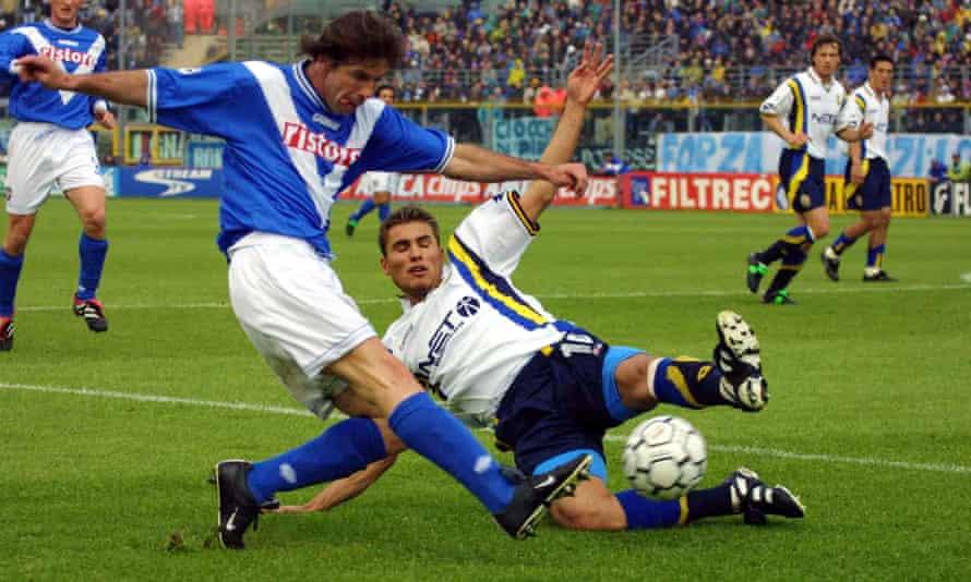 Verona's Adrian Mutu attempts to block a cross by Brescia's Filippo Galli in April 2001.