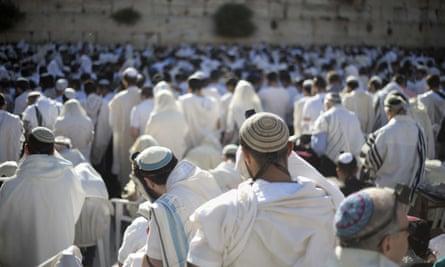 Jewish men pray at the Western Wall.