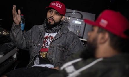 Ricardo Alves, left, and Felipe Araújo, two cousins who together make up the right-wing rap duo Mensageiros da Profecia (Messangers of the Prophecy).