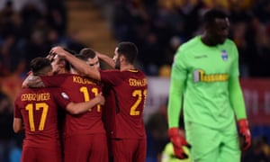 Roma players celebrate Kevin Strootman's goal at the Stadio Olimpico.