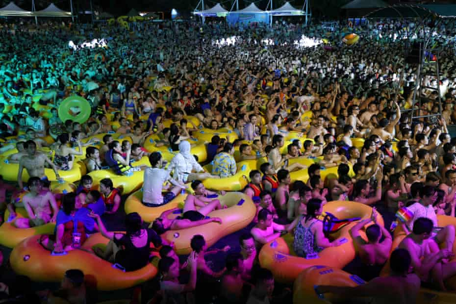 People enjoy a music party inside a swimming pool at the Wuhan Maya Beach Park, in Wuhan, following the coronavirus disease (COVID-19) outbreak, Hubei province, China August 15, 2020.