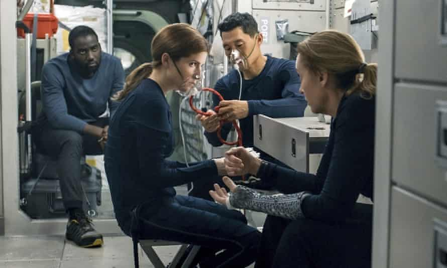 This image released by Netflix shows Shamier Anderson, from left, Anna Kendrick, Daniel Dae Kim and Toni Collette in a scene from Stowaway.