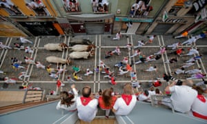 Jose Escolar Gil's fighting bulls on Estafeta Street during the fourth day of the San Fermin festival in Pamplona, Spain.