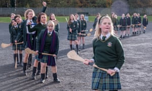 Front to back: Saoirse Monica Jackson, Nicola Coughlan, Jamie-Lee O'Donnell, Louisa Clare Harland, and Dylan Llewellyn star in Derry Girls.