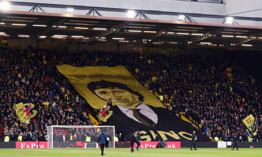 Watford fans display a banner showing the owner, Gino Pozzo. He is intimately involved in all key decisions.