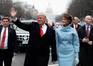 Donald Trump waves as he walks with first lady Melania Trump during his inauguration parade in Washington, January 2017.