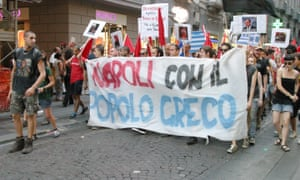 Supporters of Greece's anti-austerity protesters carry placards and banners during a solidarity march in Naples, Italy