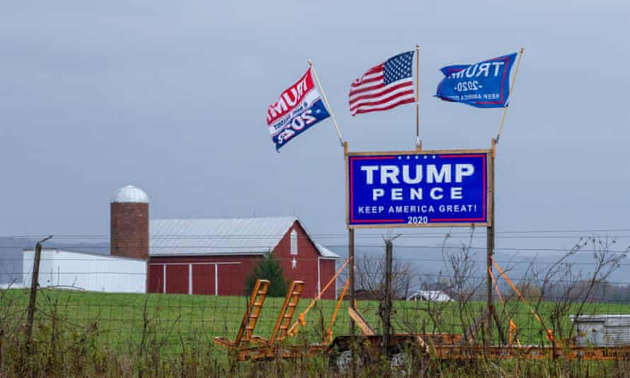 A Trump-Pence re-election sign and flags are displayed in rural central Pennsylvania. People of similar political allegiance tend to cluster together even at the neighborhood level.