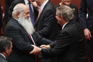 Western Australian Liberal Senator Chris Back is congratulated by Labor Pat Dodson.