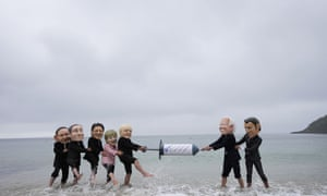 Activists wearing giant heads of the G7 leaders tussle over a giant Covid-19 vaccine syringe during an action of NGO's on Swanpool Beach in Falmouth, Cornwall, England. Depicted from left to right, Japan's Prime Minister Yoshihide Suga, Italy's Prime Minister Mario Draghi, Canadian Prime Minister Justin Trudeau, German Chancellor Angela Merkel, British Prime Minister Boris Johnson, U.S. President Joe Biden and French President Emmanuel Macron.