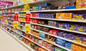 Chocolates and sweets on supermarket shelves.