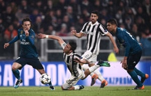 Paulo Dybala dramatically falls between Luka Modric and Casemiro and earns himself a card.