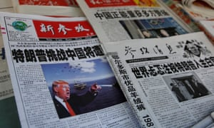 Chinese news papers showing US president Donald Trump at a newsstand in Shanghai.