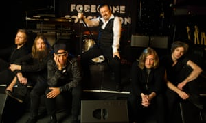 Gervais as David Brent, with his band Foregone Conclusion.