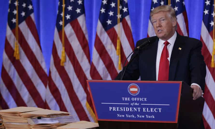 Trump used a stack of papers as evidence of his sons' 'complete and total control' of his businesses.