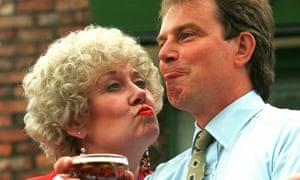 Liz Dawn tempting Tony Blair with a pint during a trip to Granada Studios.