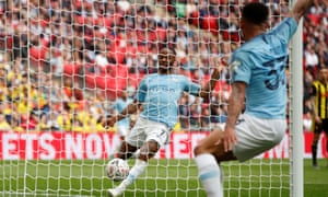 Raheem Sterling puts the ball into the Watford net – although Gabriel Jesus's shot appeared to have already crossed the line – for Manchester City's second goal.