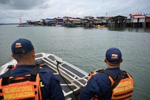 Members of the Colombian Coast Guard patrol the bay in Tumaco
