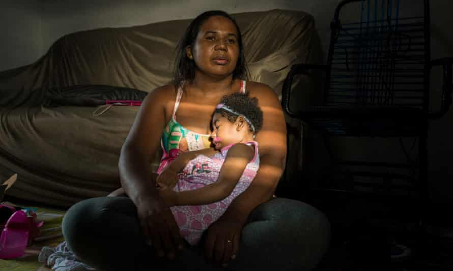 Inabela Tavares with her daughter, Gaziella, who was born with microcephaly after Inabela was infected by the Zika virus while pregnant