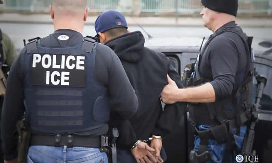 US Immigration and Customs Enforcement officers detain a suspect during an enforcement operation on 7 February in Los Angeles, California.