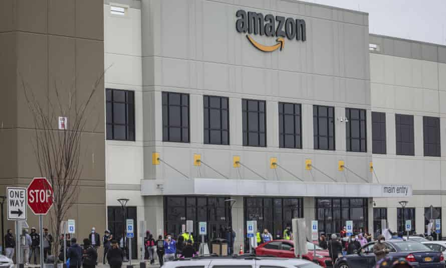 Workers at Amazon's fulfillment center in Staten Island protest work conditions in the company's warehouse in New York on 30 March 2020.