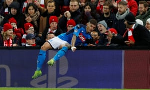 Napoli's Giovanni Di Lorenzo collides with an advertising board after being shoved by Andy Robertson.