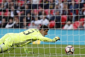 Thibaut Courtois grabs the ball as it spins back to him.