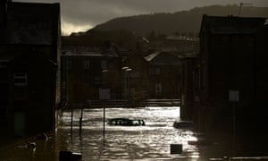 A flooded street in Mytholmroyd, West Yorkshire, after the River Calder burst its banks on 9 February.