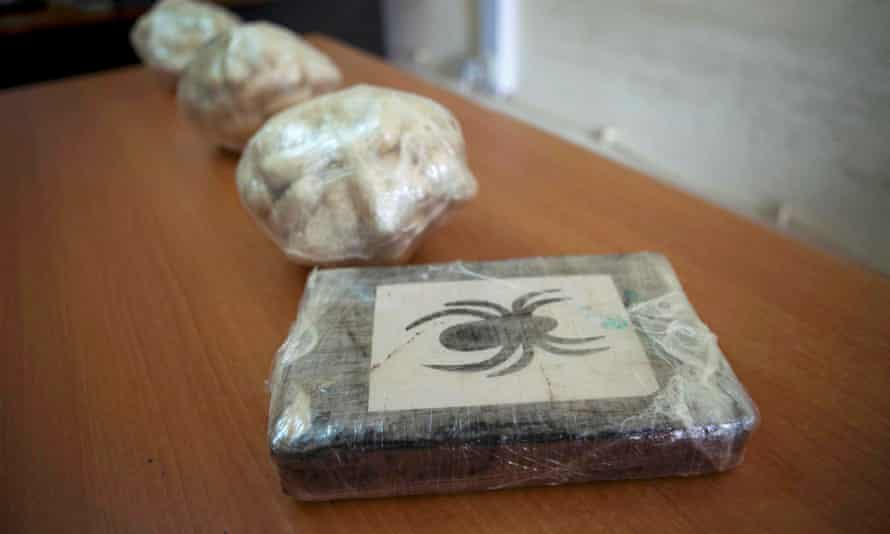 Cocaine is displayed to journalists after being seized by Guinea-Bissau's police in 2012.