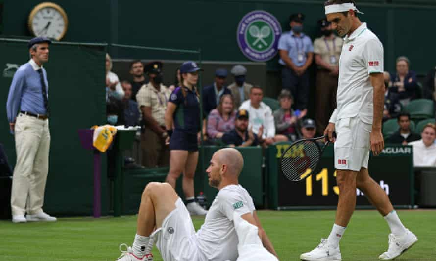 Roger Federer shows concern for his injured opponent Adrian Mannarino, who was forced to retire from the match.