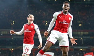 Arsenal's Danny Welbeck celebrates his second and Arsenal's third against Milan as Héctor Bellerín watches on.
