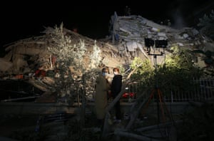 Rescue services search for survivors in the debris of a collapsed building in İzmir, Turkey