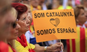 A woman holds a banner as she attends a demonstration supporting Spanish unity on 12 October in Barcelona, Spain.