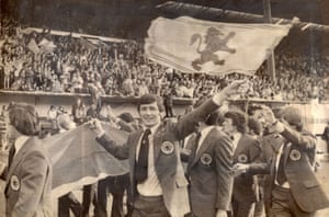 Scotland's captain Bruce Rioch and other members of the 1978 World Cup Squad wave goodbye to fans at Hampden Park.