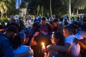 Orlando, Florida, US. Mourners gather at Eola Lake Park