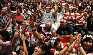 Fans enjoy Japan's victory over Scotland.
