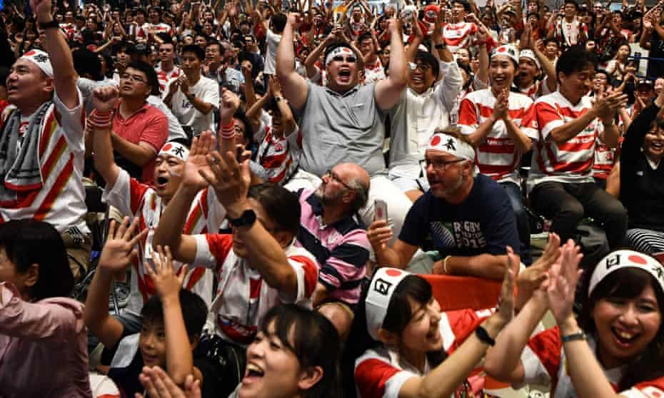 Fans enjoy Japan's victory over Scotland.