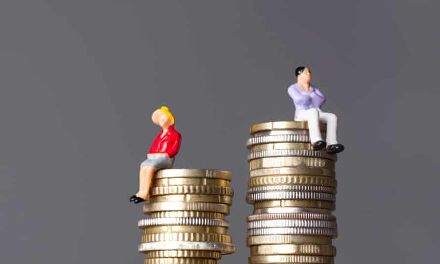 small dolls sitting on unequally stacked coins