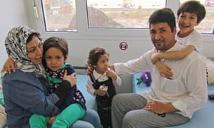 Afghan refugee family Ghazni sits in the central admission facility for refugees in Halberstadt, Germany, 07 November 2015.