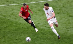 Declan Rice of England battles for possession with Andrei Cojocari of Moldova