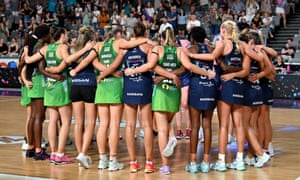 Netball players in a huddle