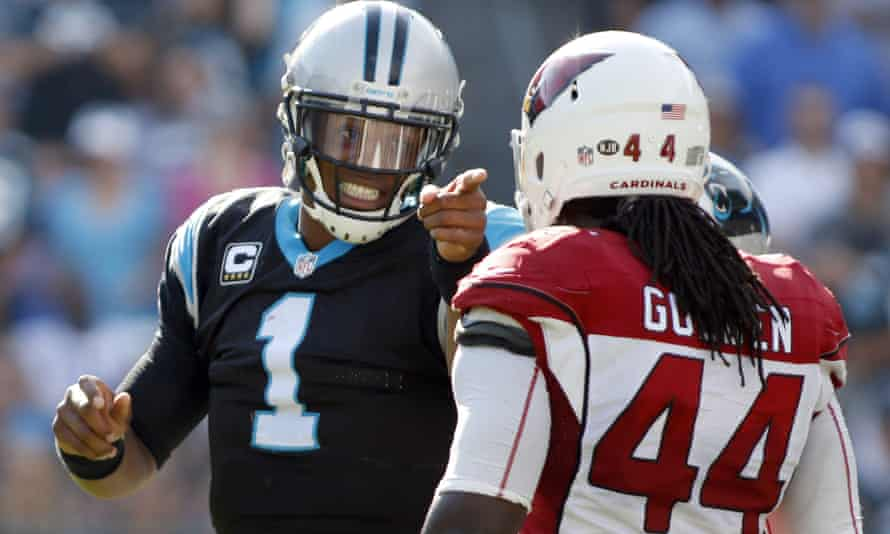 Cam Newton objects to a late hit by Arizona Cardinals' Markus Golden in the second half of Sunday's game
