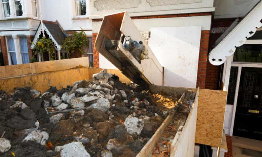 A machine removing soil from a basement.